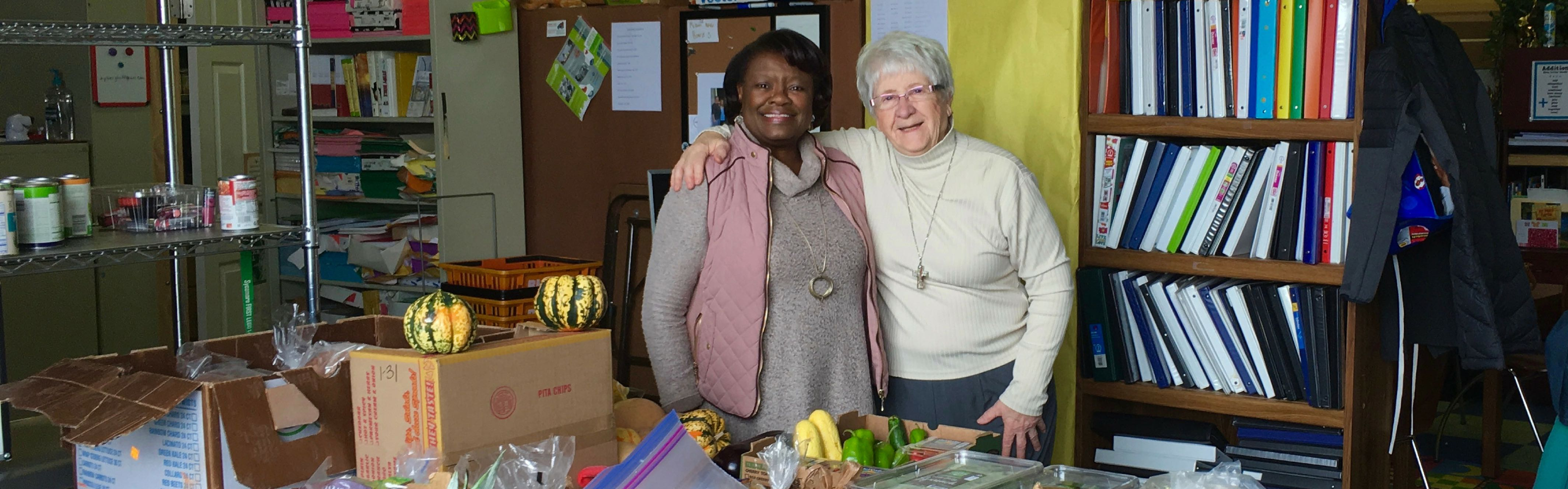 picture of Elaine Hipps and Clare Salter at Operation Give Back's warehouse